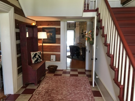 The logs of the log cabin are visible in the hallway of the house at 8939 W. Terrapin Road.