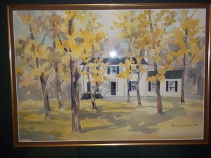 A watercolor painting of a house annotated The Dean Smith House 1982 signed by Margaret Hoyback
